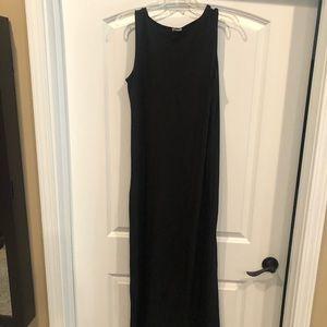 Long, sleeveless, black dress.